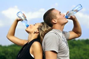 Couple with water bottles.