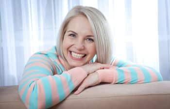 Woman Smiling After Receiving Dental Crowns Marietta GA