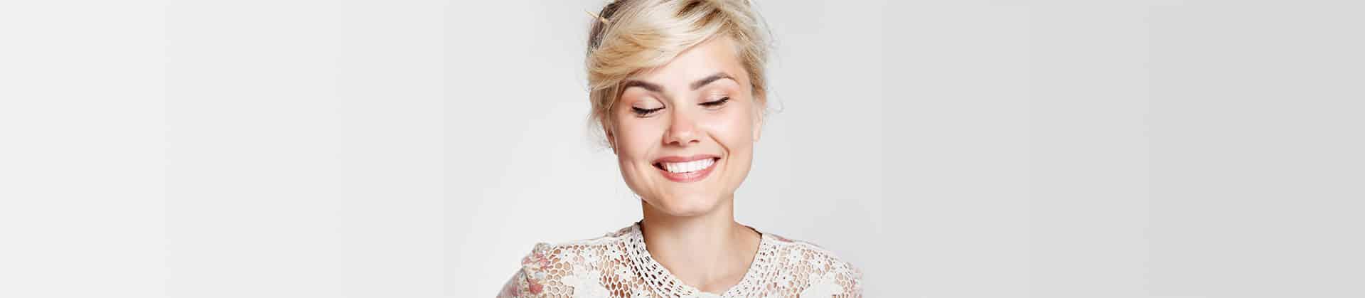 Blonde woman smilling after gummy smile treatrment Marietta, GA.