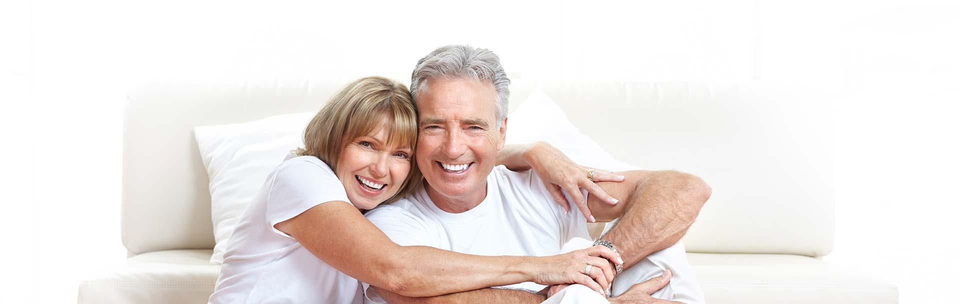 Senior couple smilling.