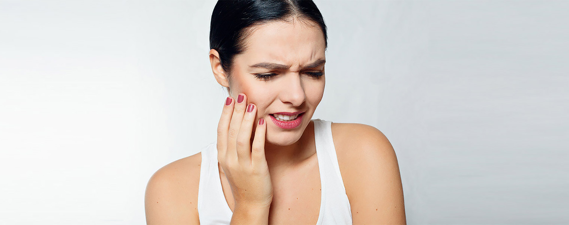 Woman with tooth pain. Emergency dentistry Marietta, GA.