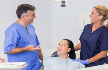 Dentist and Hygienist Discussing Treatment with Patient Marietta GA