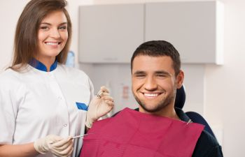 Patient With Dental Assistant Smiling Marietta GA